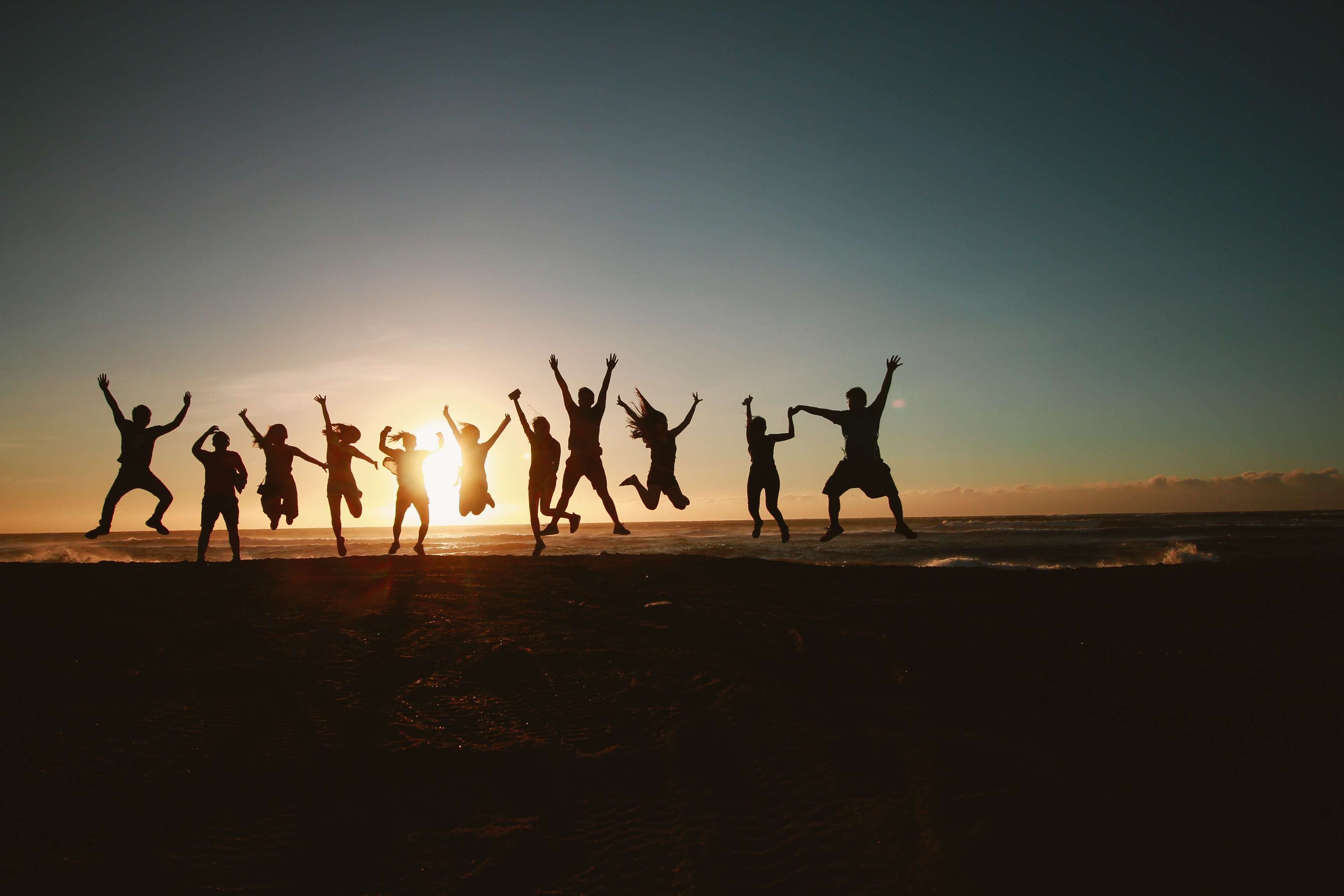 silhouette-photography-of-group-of-people-jumping-during-1000445
